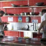 communal kitchen at nomads hostel byron bay